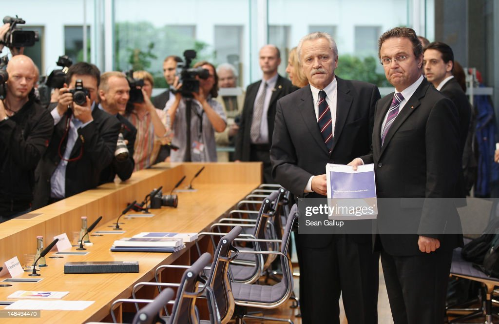 German Interior Minister HansPeter Friedrich and outgoing president of the Federal Office for the Protection of the Constitution Heinz Fromm arrive...