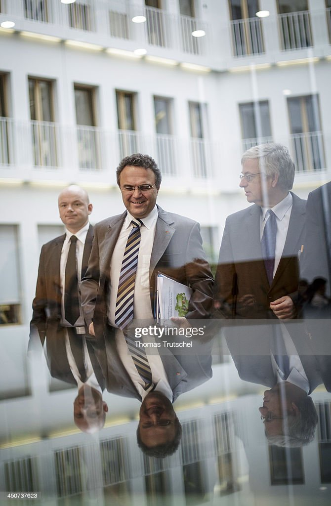 German Interior Minister <a gi-track='captionPersonalityLinkClicked' href=/galleries/search?phrase=Hans-Peter+Friedrich&family=editorial&specificpeople=7528072 ng-click='$event.stopPropagation()'>Hans-Peter Friedrich</a> arrives for a press conference at Bundespressekonferenz on November 20, 2013 in Berlin, Germany.
