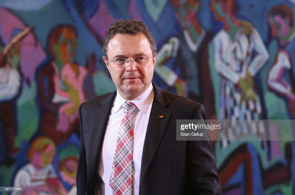 German Interior Minister <a gi-track='captionPersonalityLinkClicked' href=/galleries/search?phrase=Hans-Peter+Friedrich&family=editorial&specificpeople=7528072 ng-click='$event.stopPropagation()'>Hans-Peter Friedrich</a> arrives for the weekly German government cabinet meeting on December 6, 2012 in Berlin, Germany. German leaders recently agreed to begin legal procedures for banning the right-wing NPD political party, though Friedrich has said he is sceptical whether the move will pass Germany's Constitutional Court.