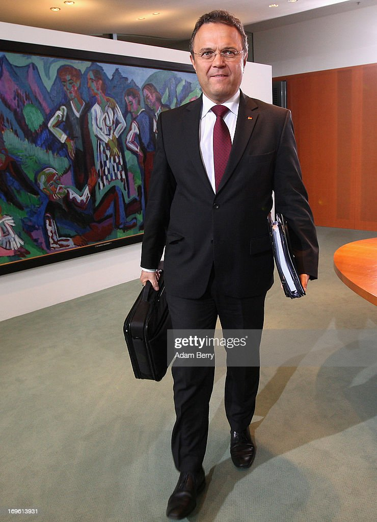 German Interior Minister HansPeter Friedrich arrives for the weekly German federal Cabinet meeting on May 29 2013 in Berlin Germany High on the...