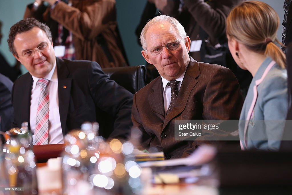 German Interior Minister <a gi-track='captionPersonalityLinkClicked' href=/galleries/search?phrase=Hans-Peter+Friedrich&family=editorial&specificpeople=7528072 ng-click='$event.stopPropagation()'>Hans-Peter Friedrich</a>, Finance Minister Wolfgang Schaeuble and Family Minister Kristina Schroeder chat upon their arrival for the weekly German government cabinet meeting on January 9, 2013 in Berlin, Germany. High on the morning's agenda was the latest government culture and education report.