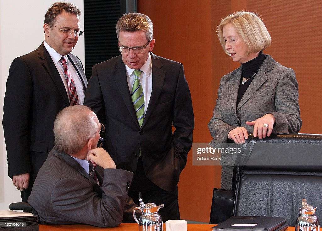 German Interior Minister Hans-Peter Friedrich, German Finance Minister Wolfgang Schaeuble, German Defense Minister Thomas de Maiziere and new German Education Minister Johanna Wanka speak to one another as they arrive for the German federal cabinet meeting on February 19, 2013 in Berlin, Germany. High on the cabinet meeting agenda will be Germany's military role in Mali, for which the country has already promised logistical support based on the situation on the ground to help an initial battle against Islamic insurgents. Germany has also pledged two C-160 transport planes as well as backing an EU plan to send 200 military advisers to the African nation.