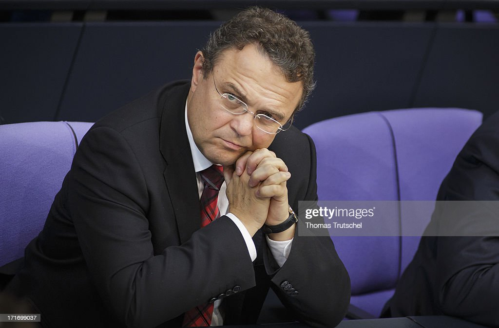 German Interior Minister <a gi-track='captionPersonalityLinkClicked' href=/galleries/search?phrase=Hans-Peter+Friedrich&family=editorial&specificpeople=7528072 ng-click='$event.stopPropagation()'>Hans-Peter Friedrich</a>, is pictured on his seat at Reichstag, the seat of the German Parliament (Bundestag), on June 27, 2013 in Berlin, Germany.
