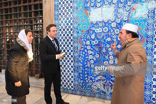 German Interior Minister HansPeter Friedrich listens to Turkish Imam Ismail Karakelle during a visit to the Rustem Pasha Mosque in Istanbul on...