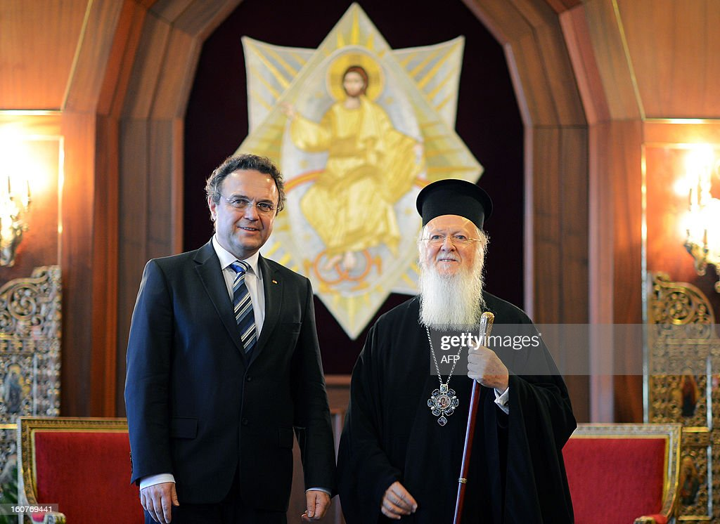 German interior minister Hans-Peter Friedrich (L) poses with Ecumenical Patriarch of Constantinople Bartholomew (R) in Istanbul on February 5, 2013. Friedrich said Turkish authorities knew the US embassy bomber was back home illegally, a day after Turkish premier accused Germany of not keeping him under surveillance during his stay there.