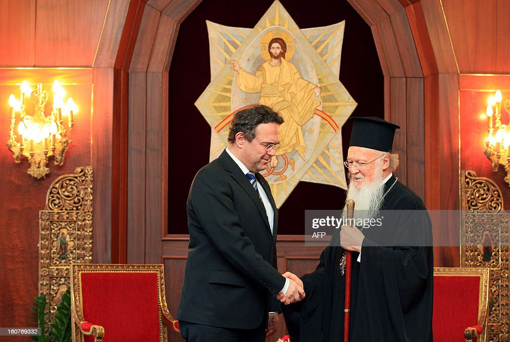German interior minister Hans-Peter Friedrich (L) shakes hand with Ecumenical Patriarch of Constantinople Bartholomew (R) in Istanbul on February 5, 2013. Friedrich said Turkish authorities knew the US embassy bomber was back home illegally, a day after Turkish premier accused Germany of not keeping him under surveillance during his stay there.