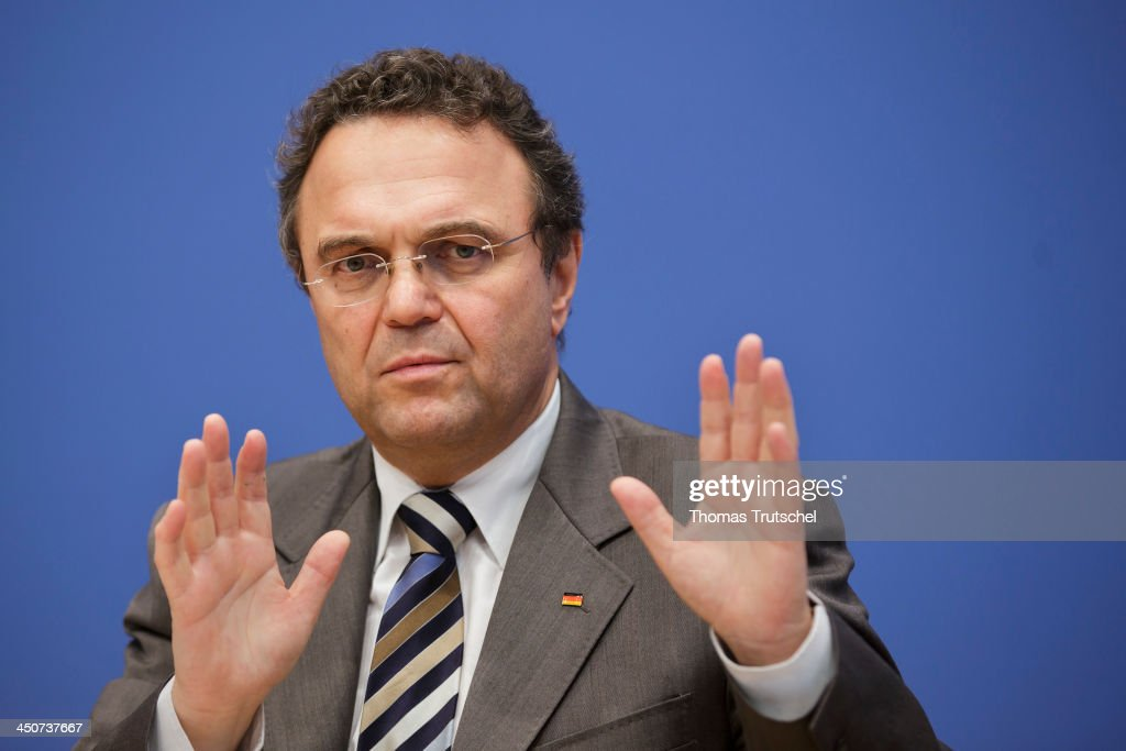 German Interior Minister <a gi-track='captionPersonalityLinkClicked' href=/galleries/search?phrase=Hans-Peter+Friedrich&family=editorial&specificpeople=7528072 ng-click='$event.stopPropagation()'>Hans-Peter Friedrich</a> speak to the media at Bundespressekonferenz on November 20, 2013 in Berlin, Germany.