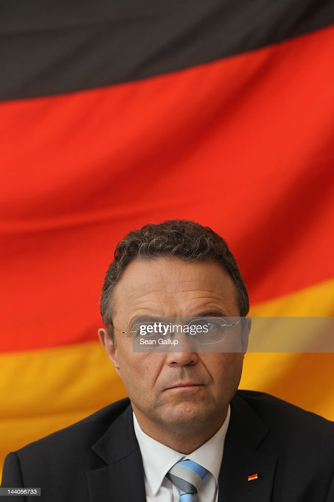 German Interior Minister <a gi-track='captionPersonalityLinkClicked' href=/galleries/search?phrase=Hans-Peter+Friedrich&family=editorial&specificpeople=7528072 ng-click='$event.stopPropagation()'>Hans-Peter Friedrich</a> speaks to the media after touring the expanded youth arrest facility in Lichtenrade district on May 9, 2012 in Berlin, Germany. The facility accomodates young men and women first-time offenders for short periods of time with the intent of giving them an impression of what prison is like yet to also give them a second chance at returning to freedom.