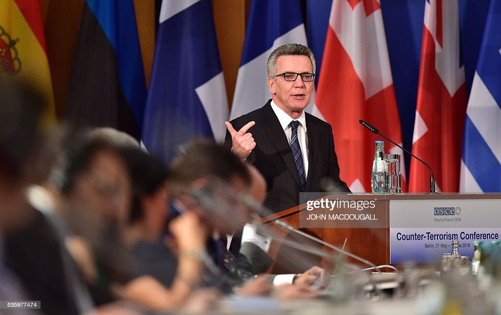 German Interior Minister Thomas de Maiziere addresses delegates during the opening session of the two-day Counter-Terrorism Conference of the Organisation for Security and Cooperation in Europe (OSCE) at the foreign ministry in Berlin on May 31, 2016. / AFP / John MACDOUGALL