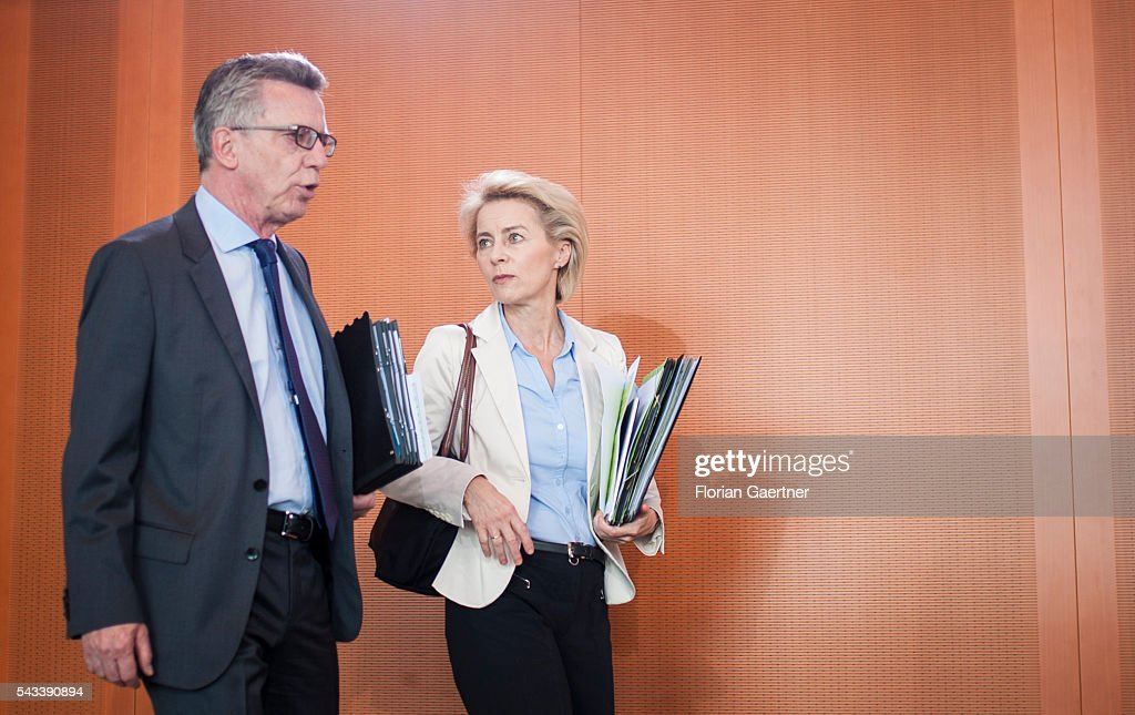 German Interior Minister Thomas de Maiziere (L) and German Defense Minister Ursula von der Leyen (R) arrive for the weekly cabinet meeting at the chancellery (Bundeskanzleramt) on June 28, 2016 in Berlin, Germany.