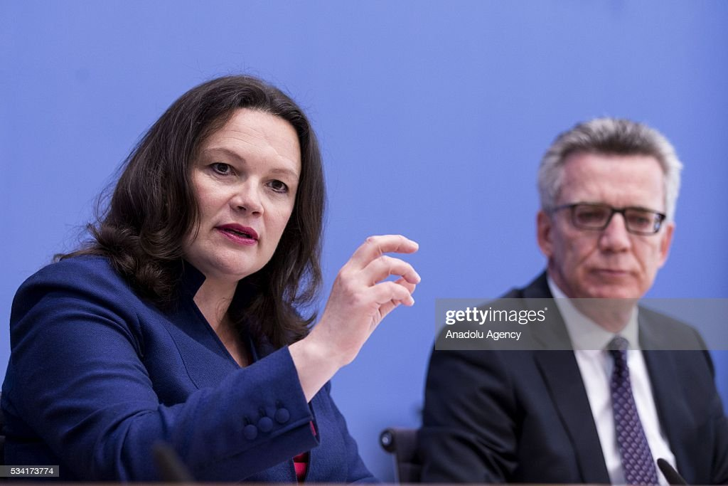 German Interior Minister Thomas de Maiziere (R) and German Labour and Social Minister Andrea Nahles (L) give a press conference about the integration issue on May 25, 2016 in Berlin.