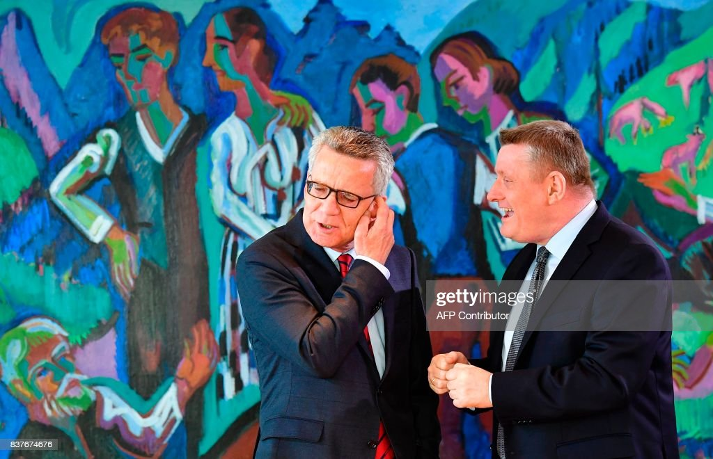 German Interior minister Thomas de Maiziere (L) and Health minister Hermann Groehe chat before the weekly cabinet meeting in Berlin, on August 23, 2017. /