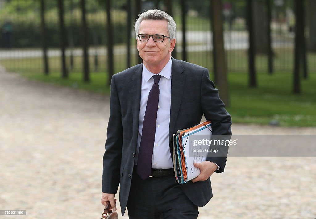 German Interior Minister <a gi-track='captionPersonalityLinkClicked' href=/galleries/search?phrase=Thomas+de+Maiziere&family=editorial&specificpeople=618845 ng-click='$event.stopPropagation()'>Thomas de Maiziere</a> arrives for a meeting of the government cabinet at Schloss Meseberg palace on May 24, 2016 near Gransee, Germany. The government cabinet is meeting at Schloss Meseberg for a two-day retreat.