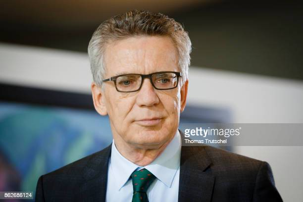 German Interior Minister Thomas de Maiziere arrives for the weekly cabinet meeting at the chancellery on October 18 2017 in Berlin Germany