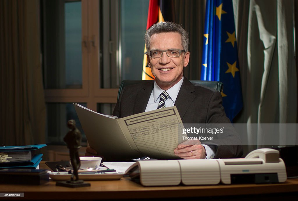 German Interior Minister <a gi-track='captionPersonalityLinkClicked' href=/galleries/search?phrase=Thomas+de+Maiziere&family=editorial&specificpeople=618845 ng-click='$event.stopPropagation()'>Thomas de Maiziere</a>, CDU seated at his desk reading a file in the Ministry of the Interior poses for a photograph on January 07, 2014 in Berlin, Germany.