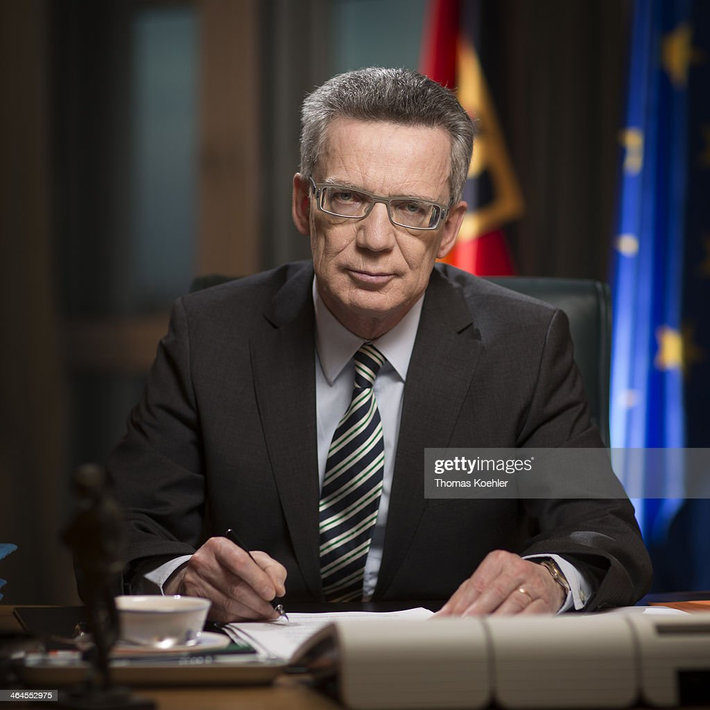 German Interior Minister <a gi-track='captionPersonalityLinkClicked' href=/galleries/search?phrase=Thomas+de+Maiziere&family=editorial&specificpeople=618845 ng-click='$event.stopPropagation()'>Thomas de Maiziere</a>, CDU seated at his desk in the Ministry of the Interior poses for a photograph on January 07, 2014 in Berlin, Germany.