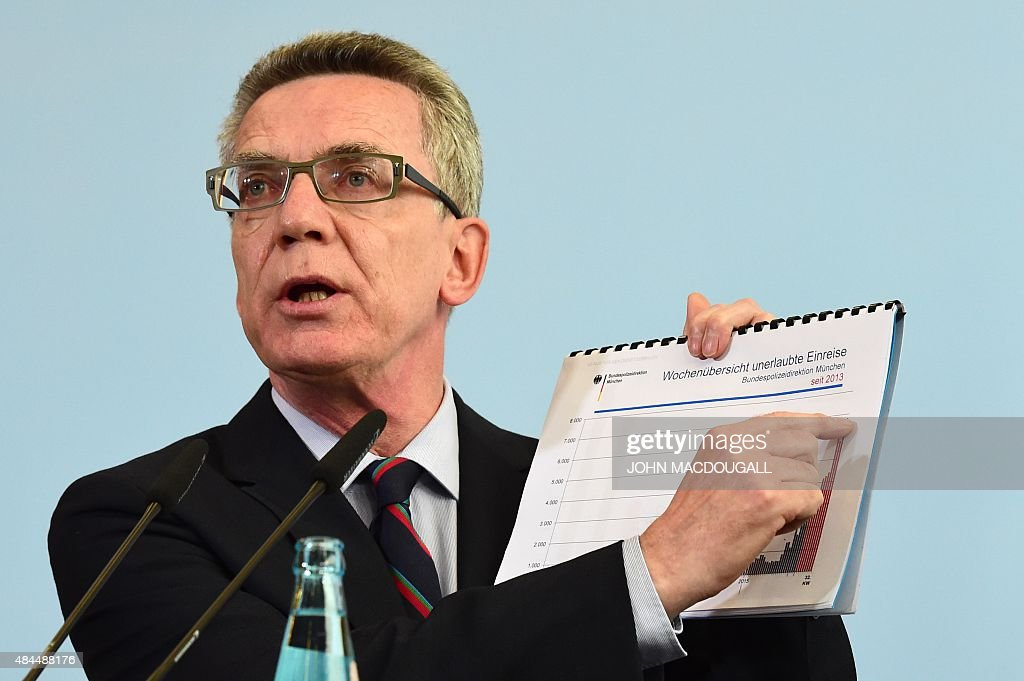 German Interior Minister Thomas de Maiziere delivers a statement on a ...
