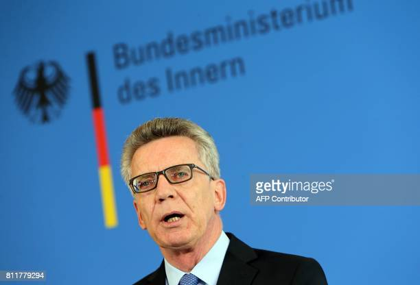 German Interior Minister Thomas de Maiziere delivers a statement on the riots during the G20 summit in Hamburg on July 10 2017 in Berlin / AFP PHOTO...