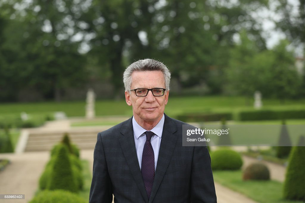 German Interior Minister <a gi-track='captionPersonalityLinkClicked' href=/galleries/search?phrase=Thomas+de+Maiziere&family=editorial&specificpeople=618845 ng-click='$event.stopPropagation()'>Thomas de Maiziere</a> departs after speaking to the media following a meeting of the government cabinet at Schloss Meseberg palace on May 24, 2016 near Gransee, Germany. The government cabinet is meeting at Schloss Meseberg for a two-day retreat to principally discuss Germany's digital future.