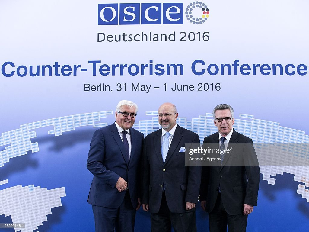 German Interior Minister Thomas de Maiziere (R), German Foreign Minister Frank-Walter Steinmeier (L), and OSCE Secretary General Lamberto Zannier (C) pose for a photo during the Counter-Terrorism Conference of the Organisation for Security and Cooperation in Europe (OSCE) at the foreign ministry in Berlin, Germany on May 31, 2016.
