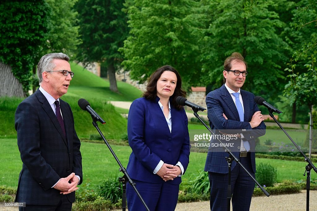 German Interior Minister Thomas de Maiziere, German Labour and Social Minister Andrea Nahles and German Transport Minister Alexander Dobrindt speak to the press at Meseberg Palace on May 24, 2016 outside Berlin / AFP / TOBIAS