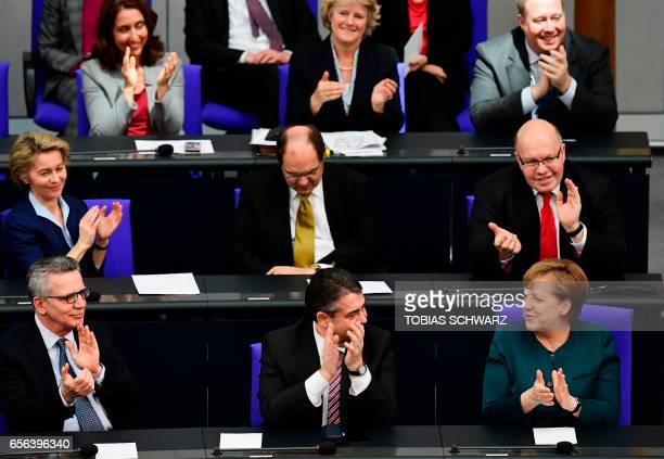 German Interior Minister Thomas de Maiziere German Vice Chancellor and Foreign Minister Sigmar Gabriel and German Chancellor Angela Merkel and German...
