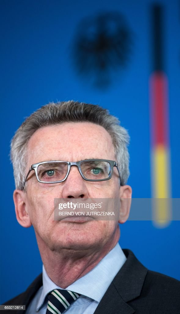 German Interior Minister Thomas de Maiziere gives a press conference on March 14, 2017 in Berlin after a meeting with the steering committee of the German Conference on Islam. De Maiziere said Ankara was playing the role of the victim with its broadsides against NATO allies, as it seeks to galvanise support ahead of a key referendum. / AFP PHOTO / dpa / Bernd von Jutrczenka / Germany OUT