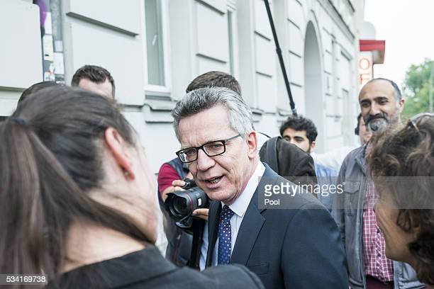 German Interior Minister Thomas de Maiziere is seen during his visit to an integration project named 'Heroes' on May 25 2016 in Berlin Germany...
