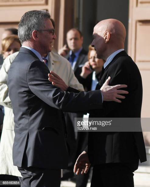 German Interior Minister Thomas de Maiziere is welcomed by Italian Interior Minister Marco Minniti for a contact group meeting to discuss migration...
