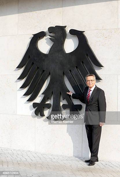 German Interior Minister Thomas de Maiziere reveals the federal eagle at the new building of the Federal Ministry of the Interior on October 2 2014...