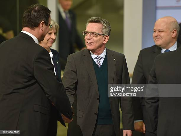 German Interior Minister Thomas de Maiziere shakes hands with another participant of an Informal Meeting of Ministers for Justice and Home Affairs of...