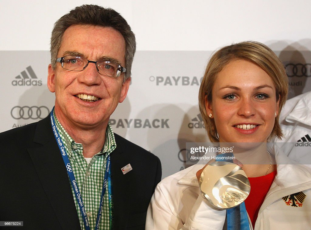 German Interior Minister Thomas de Maiziere talks to Magdalena Neuner of Germany, silver medalist in the Women's Biathlon 7.5 km Sprint on day 2 of the Vancouver 2010 Winter Olympics at the German House on February 13, 2010 in Whistler, Canada.