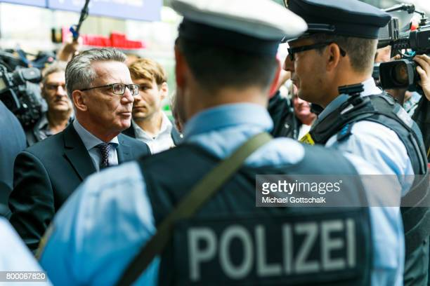 German Interior Minister Thomas de Maiziere talks to police officers during his visit to the police station of German Bundespolizei or Federal Police...