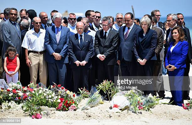 German Interior Minister Thomas de Maiziere Tunisia's Interior Minister Mohamed Gharsalli and British Home Secretary Theresa May look on after laying...