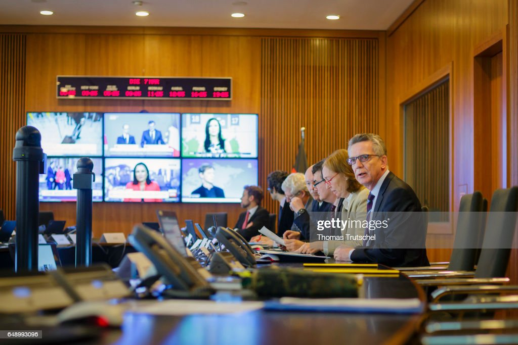 German Interior Minister Thomas de Maiziere (R) visits the situation room at the Ministry of Interior during the current GETEX joint exercises between German police and military on March 7, 2017 in Berlin, Germany. GETEX, short for the Joint Terrorism Defense Exercise, is taking place across Germany to simulate the joint operations capabilities between German law enforcement agencies and the Bundeswehr, Germany's armed forces, in battling larger-scale terror threats.