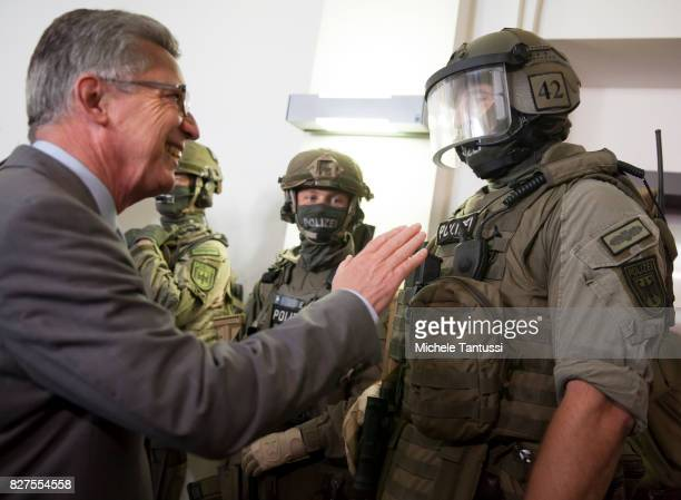 German Interior Minister Thomas de Maziere speaks with officiers of the Police special forces or GSG9 during the opening of the new Headquarters on...