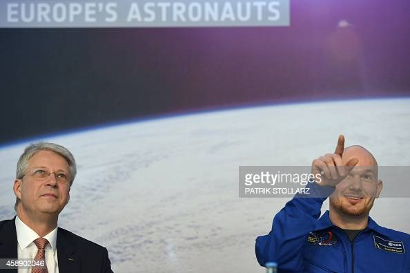 German International Space Station crew member Alexander Gerst gestures next to German astronaut and director at the European Space Agency Thomas...