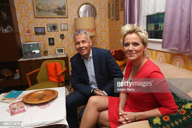 German Journalist Peter Kloepel and German Singer and Actress Inka Bause participate in a photo call in a reconstruction of a typical East German...