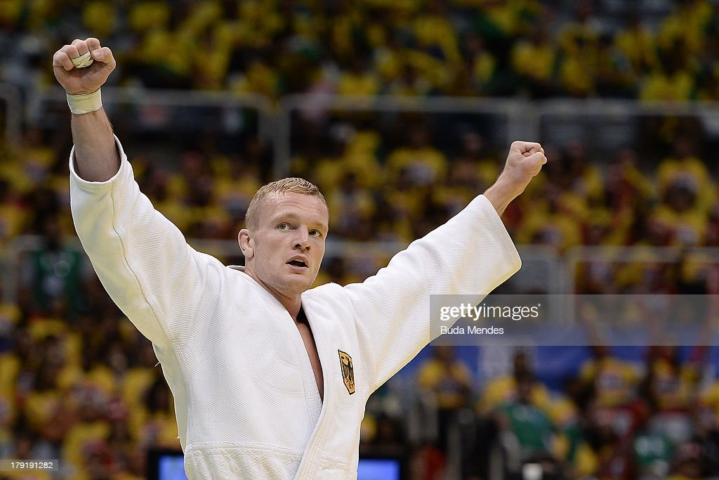 German judoka <a gi-track='captionPersonalityLinkClicked' href=/galleries/search?phrase=Dimitri+Peters&family=editorial&specificpeople=875495 ng-click='$event.stopPropagation()'>Dimitri Peters</a> celebrates a victory and bronze medal in the Men's -100kg category during the IJF World Judo Championship at Gymnasium Maracanazinho on August 31, 2013 in Rio de Janeiro, Brazil.