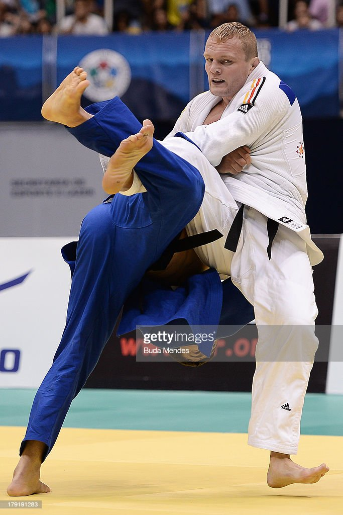 German judoka <a gi-track='captionPersonalityLinkClicked' href=/galleries/search?phrase=Dimitri+Peters&family=editorial&specificpeople=875495 ng-click='$event.stopPropagation()'>Dimitri Peters</a> (white) competes with Uzbekistan's Soyib Kurbanov in the Men's -100kg category medal bronze, during the IJF World Judo Championship at Gymnasium Maracanazinho on August 31, 2013 in Rio de Janeiro, Brazil.