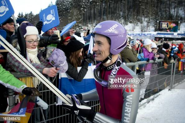 German jumper Martin Schitt gives autographs to fans after the cancellation of the FIS Ski Jumping World Cup individual large hill competition on the...