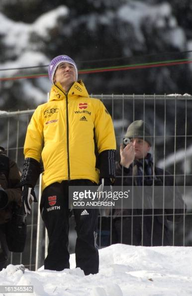 German jumper Martin Schitt looks up at the sky as the start of the FIS Ski Jumping World Cup individual large hill competition has been delayed on...
