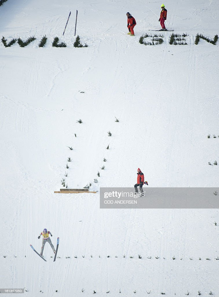 German jumper Martin Schitt makes a show jump after the cancellation of the FIS Ski Jumping World Cup individual large hill competition on the Muehlenkopfschanze hill in Willingen, western Germany on February 10, 2013.