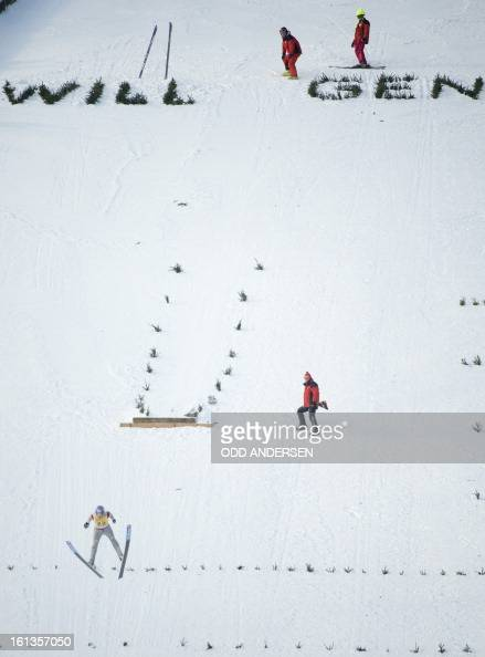 German jumper Martin Schitt makes a show jump after the cancellation of the FIS Ski Jumping World Cup individual large hill competition on the...