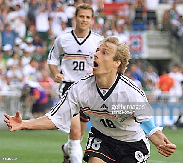 German Jurgen Klinsmann celebrates after scoring the first goal followed by teammate Oliver Bierhoff 29 June at the Stade de la Mosson in Montpellier...