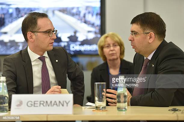 German Justice Minister Heiko Maas talks with his Romanian counterpart RobertMarius Cazanciuc during an Informal meeting of Ministers for Justice and...