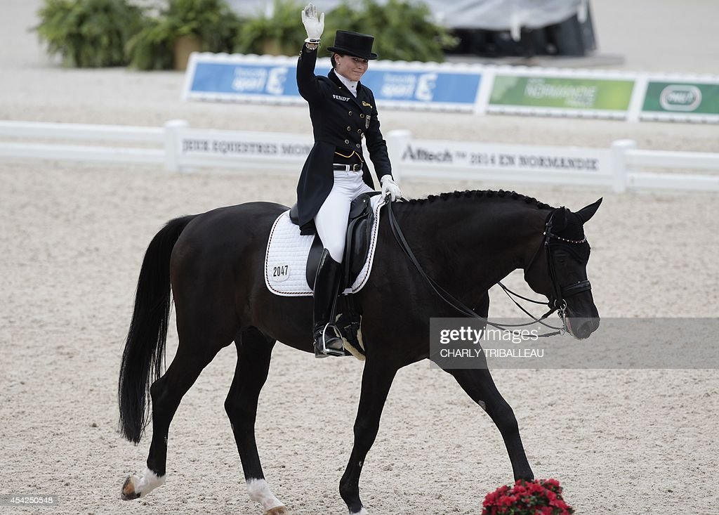 German Kristina Sprehe rides Desperados FRH on August 27, 2014 during the Individual Dressage Grand Prix of the 2014 FEI World Equestrian Games at D'Ornano Stadium in the northwestern French city of Caen.