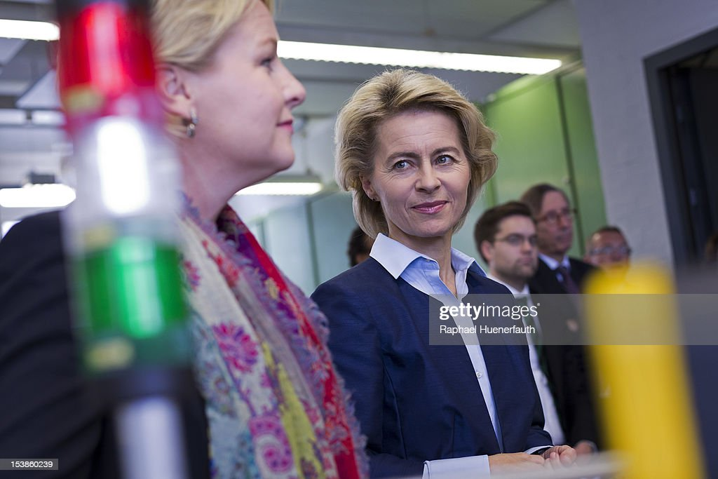 German Labor Minister Ursula von der Leyen (R) and her Swedish counterpart Hillevi Engstroem (L) visit trainees at Siemens on October 10, 2012 in Berlin, Germany.