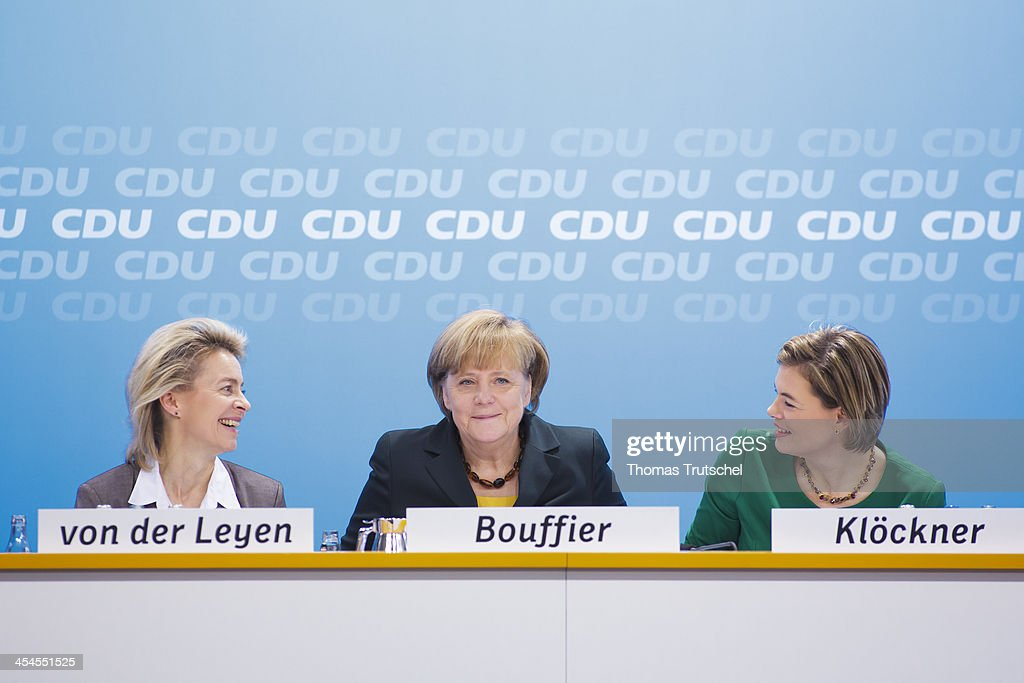 German Labor Minister <a gi-track='captionPersonalityLinkClicked' href=/galleries/search?phrase=Ursula+von+der+Leyen&family=editorial&specificpeople=4249207 ng-click='$event.stopPropagation()'>Ursula von der Leyen</a>, German Chancellor <a gi-track='captionPersonalityLinkClicked' href=/galleries/search?phrase=Angela+Merkel&family=editorial&specificpeople=202161 ng-click='$event.stopPropagation()'>Angela Merkel</a>, and <a gi-track='captionPersonalityLinkClicked' href=/galleries/search?phrase=Julia+Kloeckner&family=editorial&specificpeople=6902085 ng-click='$event.stopPropagation()'>Julia Kloeckner</a> head of CDU in the German State of Rhineland-Palatinate, during the Federal Committee of the CDU on December 09, 2013 at the Hotel Intercontinental in Berlin, Germany. (Merkel met with 180 members of the Christian Democrats (CDU) to vote on a coalition deal with the Social democrats. There were no votes against the deal, which the Social Democrats (SPD) will vote on later this week.