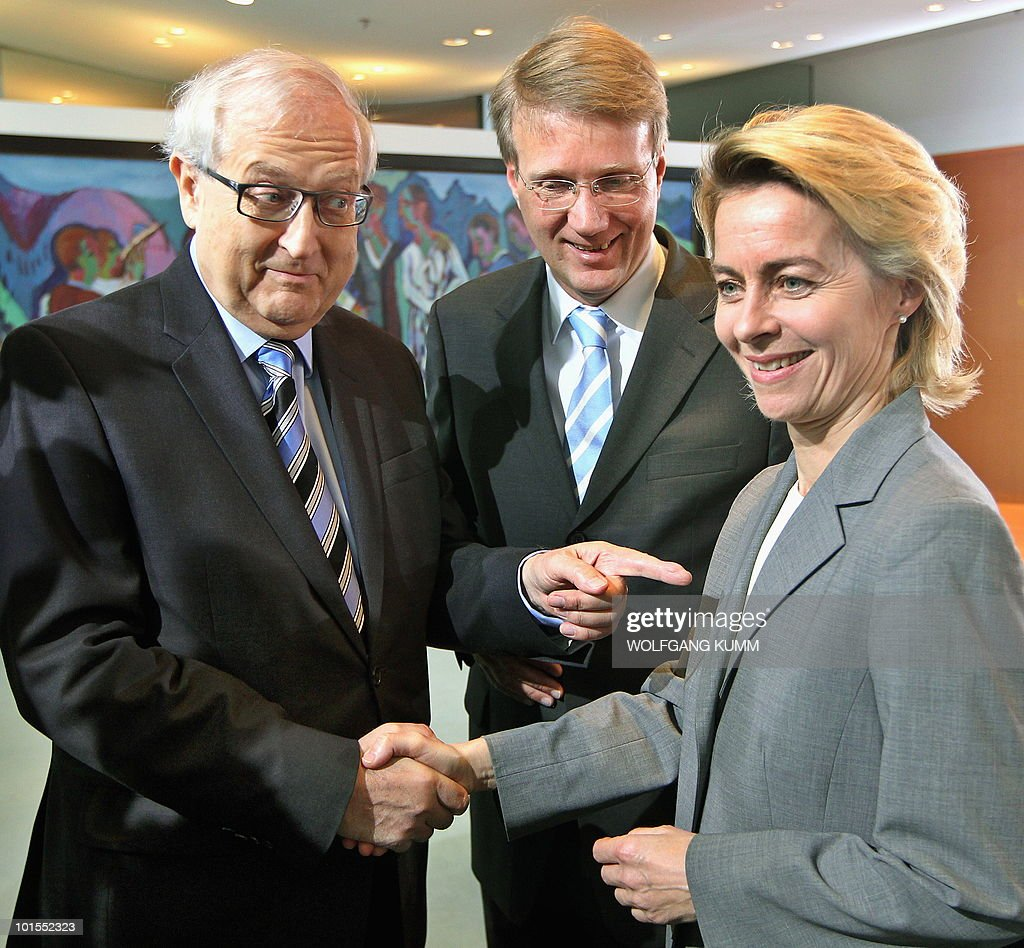 German Labour and Social Affairs Minister Ursula von der Leyen (R) is greeted by German Economy Minister Rainer Bruederle (L) as Ronald Pofalla (C), Head of the Chancellery, looks on at the beginning of a cabinet's meeting on June 2, 2010 in Berlin. Germany's cabinet approved a draft law expanding a ban on naked short selling to include all stocks traded on the German market, a government spokesman told AFP.